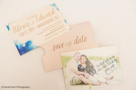 Watercolor blues and blushes are perfect for a stand-out winter wedding, featuring gorgeous engagement photos and a romantic sleeve enclosure.