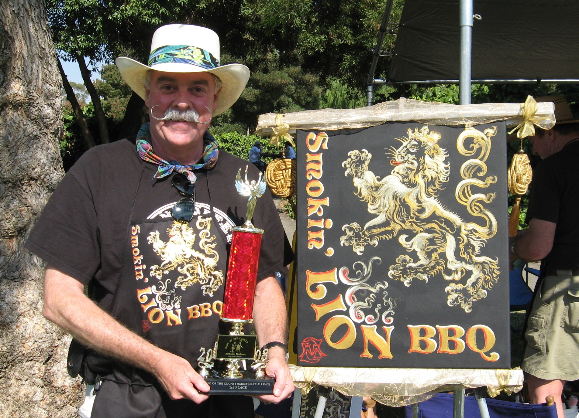 Smokin' LION BBQ Original Canvas and Chef holding 1st Place Award