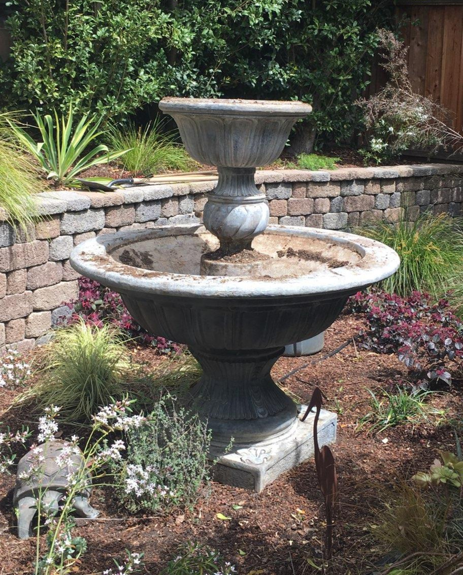 Amason's empty fountain ready for replanting on Sat., April 6, 2019.jpg