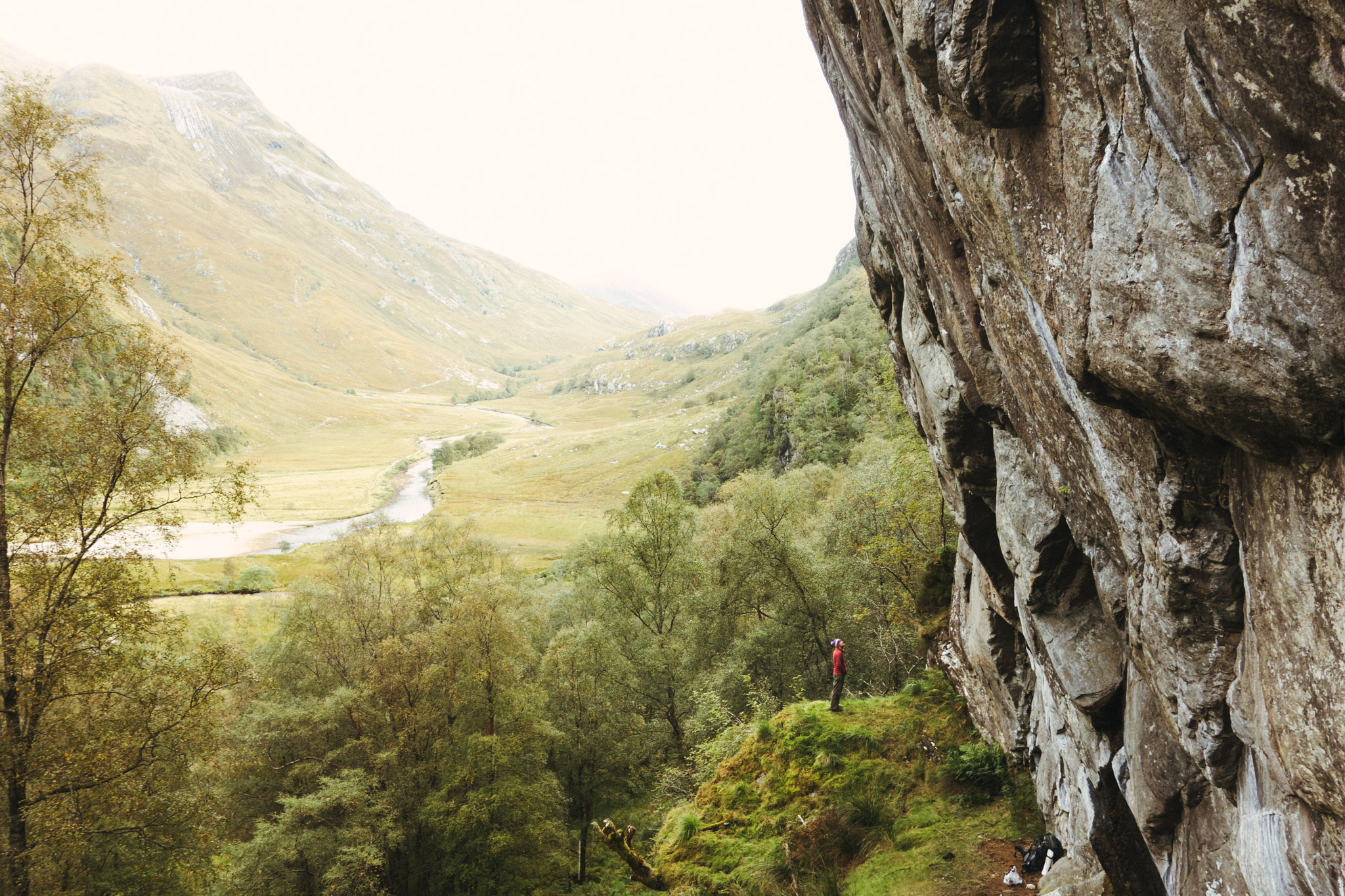 ©TomWoollard_Climbing_lifestyle-editorial-climber-in-epic-landscape-looking-at-massive-rockface-Scotland.jpg