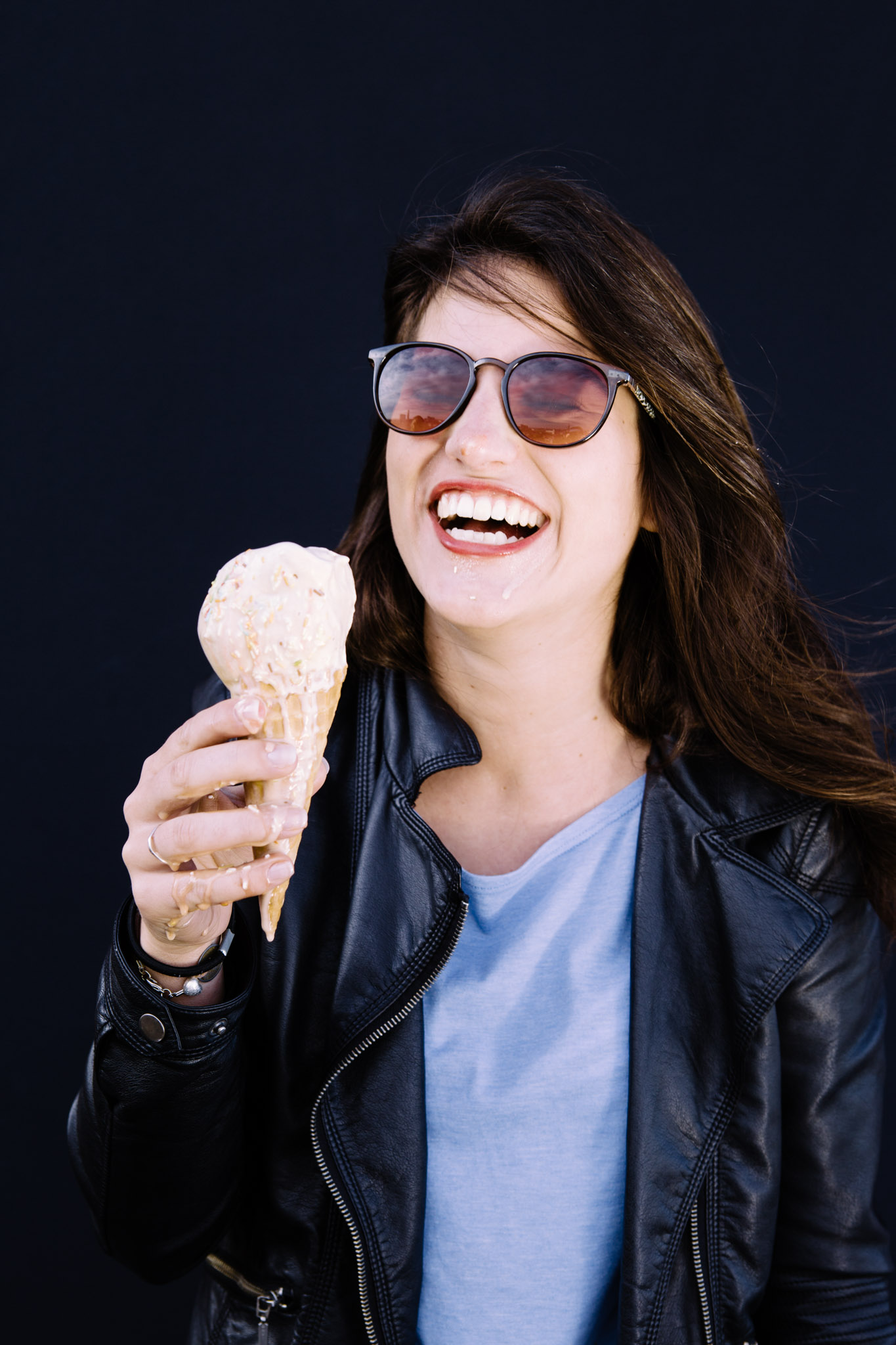 ©TomWoollard_editorial-lifestyle-young-beautiful-woman-sunglasses-eating-dripping-ice-cream-cone-laughing.jpg