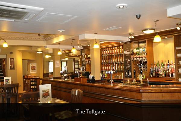 THE TOLLGATE |  +44 161 312 2308  Tollgate right across from Metrolink Station and about a 10-minute walk from Old Trafford. The place is always bustling on game days.   Address:  Seymour Grove, Old Trafford, Manchester, M16 0TG