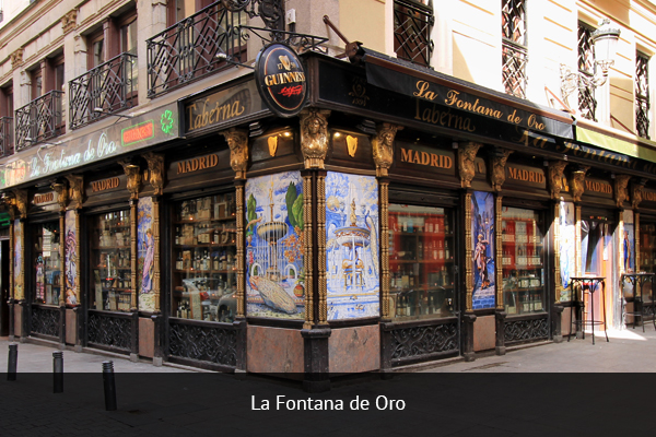 LA FONTANA DE ORO| +  34 914 29 32 1   Located on Calle de la Victoria, La Fontana de Oro is a traditional Spanish bar, offering the perfect mix of drinks and food, as well as plenty of big screens to watch the football matches.   Address:  Calle de la Victoria, 1, 28012