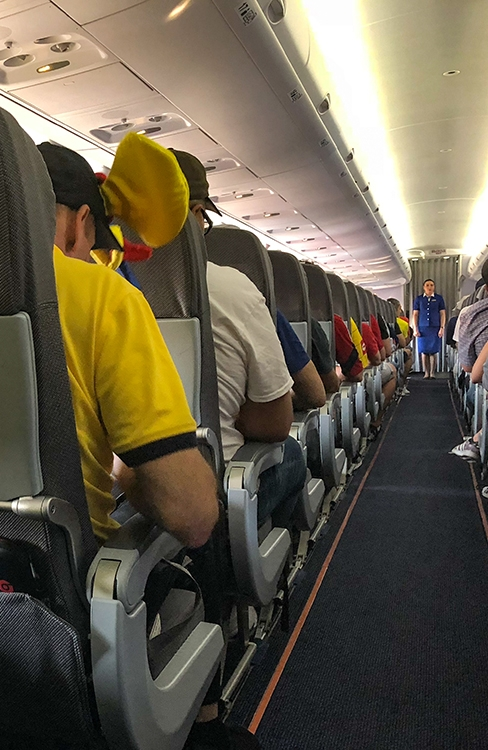 The entire flight was full of yellow, blue and red jerseys from theColombian Fans.