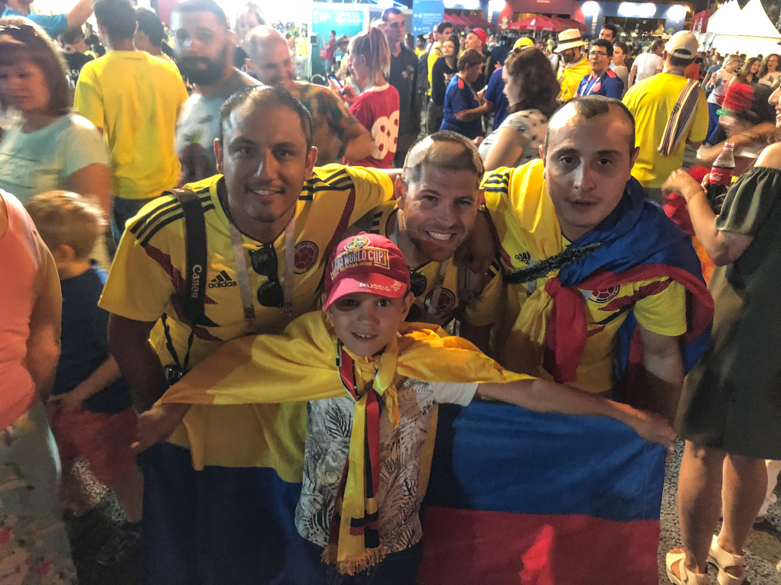 With the little Zhenia, the 8-year old Russian kid that we meet at the Fan Fest. Read more about his story  here .