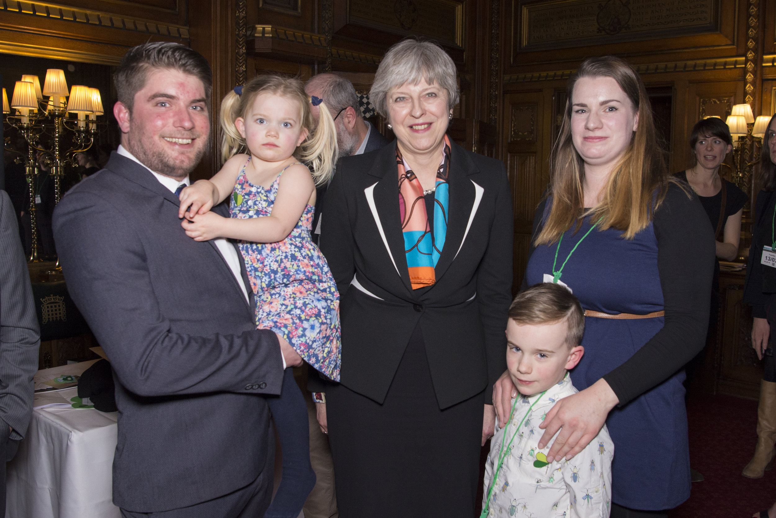 Theresa May with family at climate change awards parliamentary event (Heather Stuckey).jpg