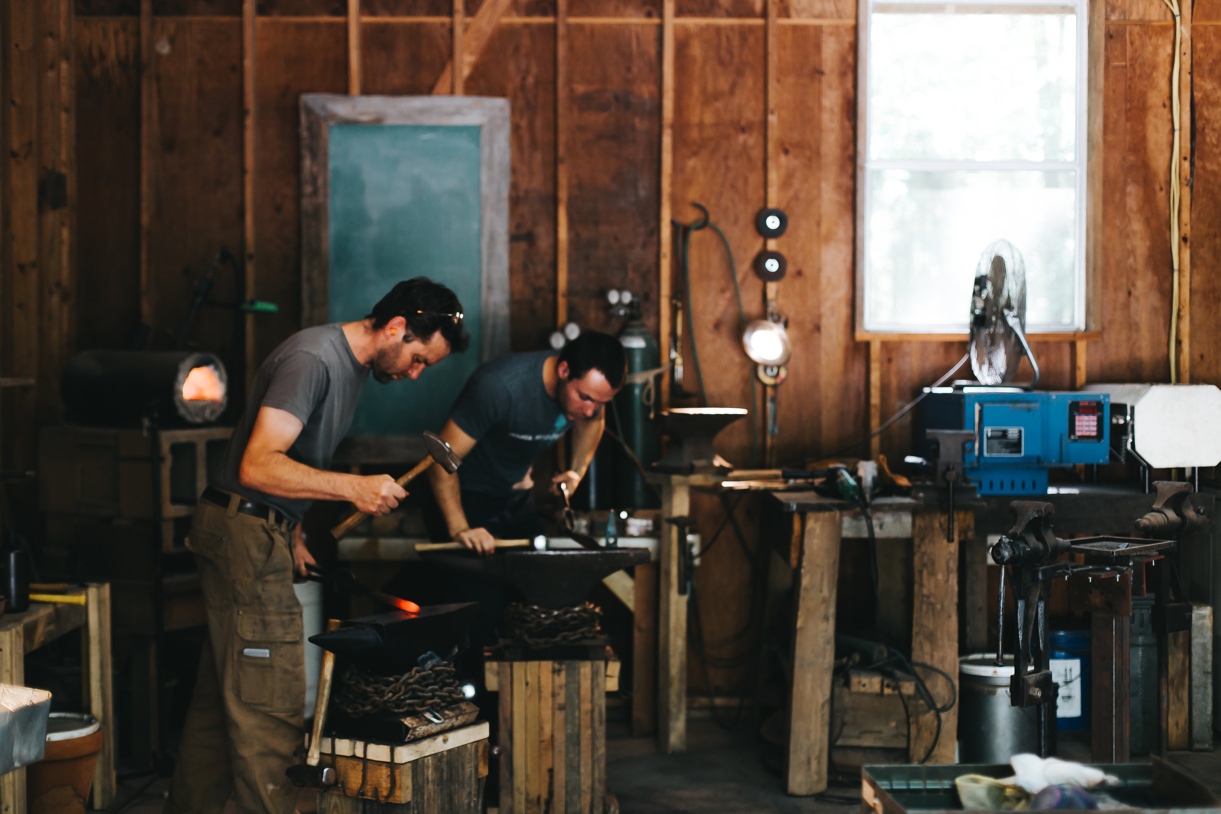David Van Wyk (left) and Luke Snyder working in the shop. Photo by Paige French.