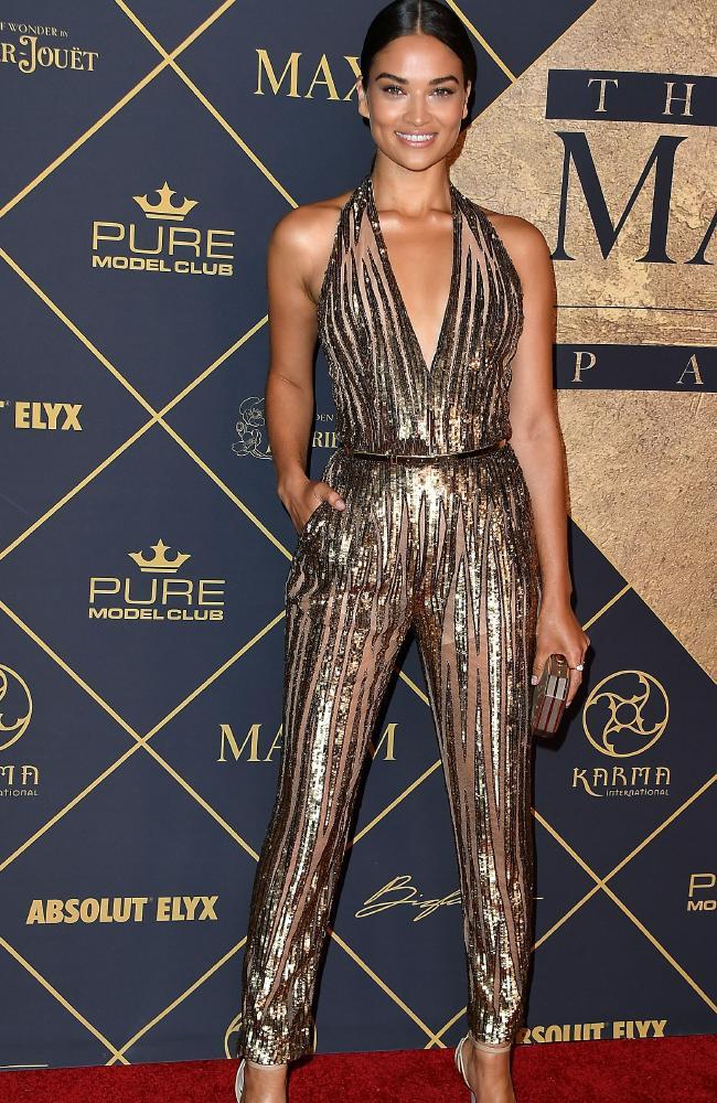 Model Shanina Shaik wearing metallic jumpsuit