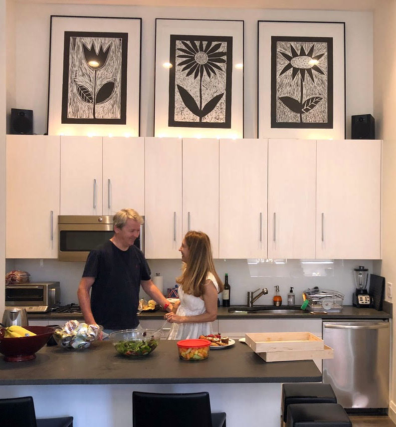 My husband, Mike, and I in our kitchen with some of Pamela's prints