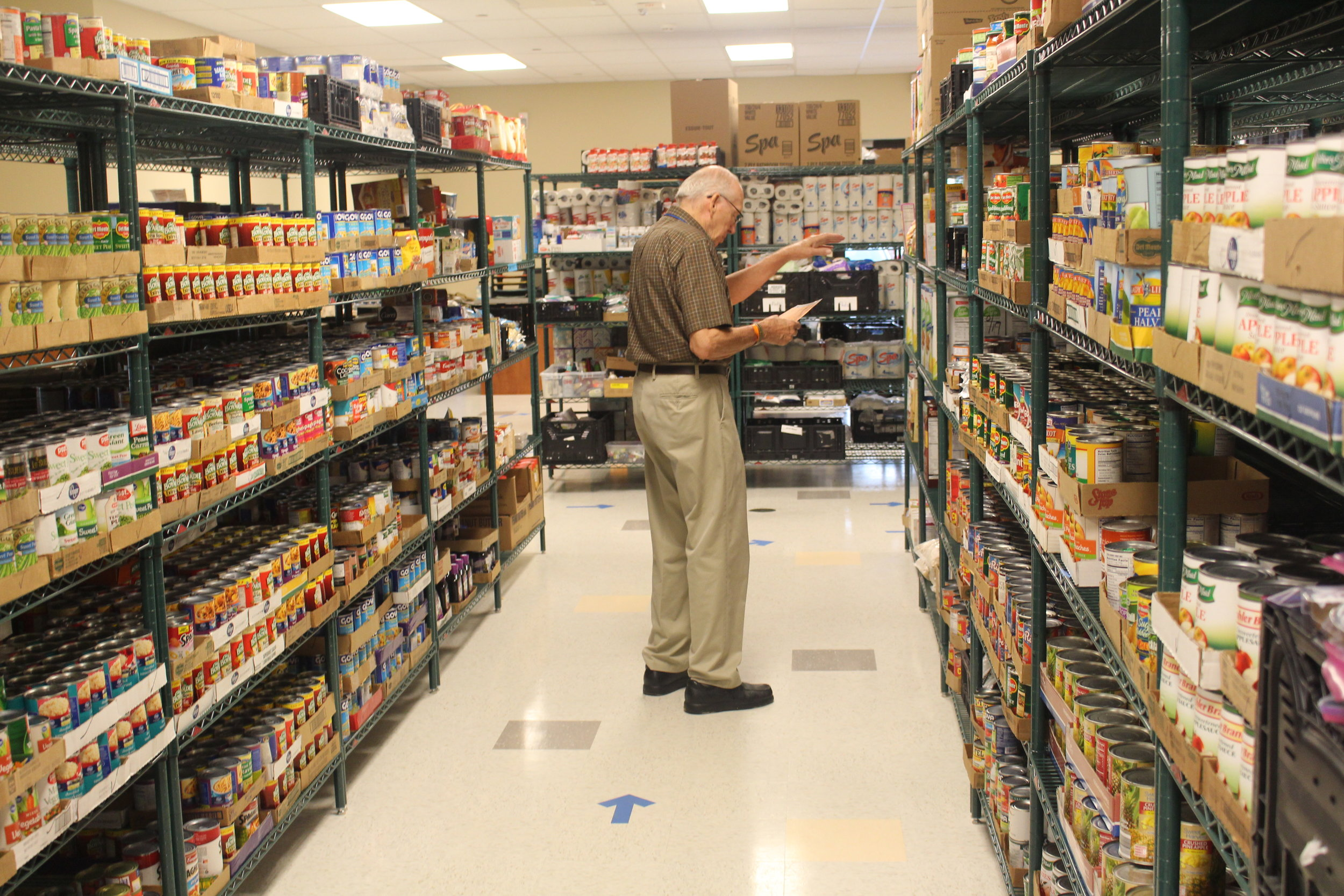 Mercy Ministry food pantry volunteer man.JPG