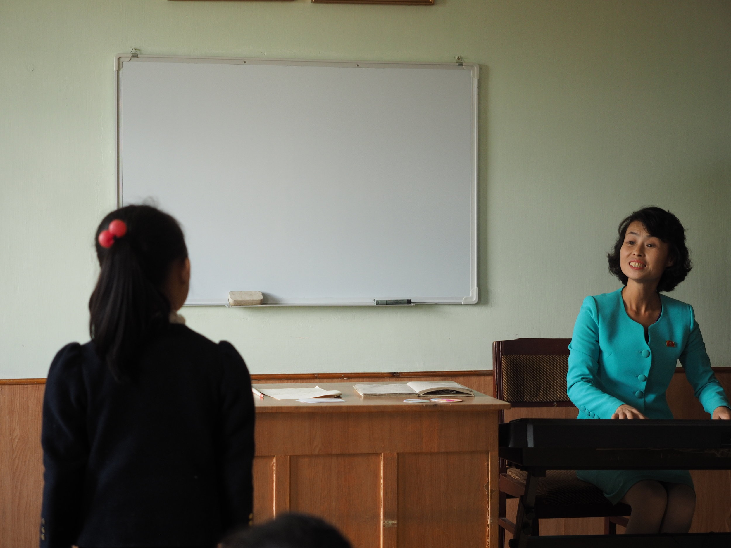 A North Korean music teacher and her student.