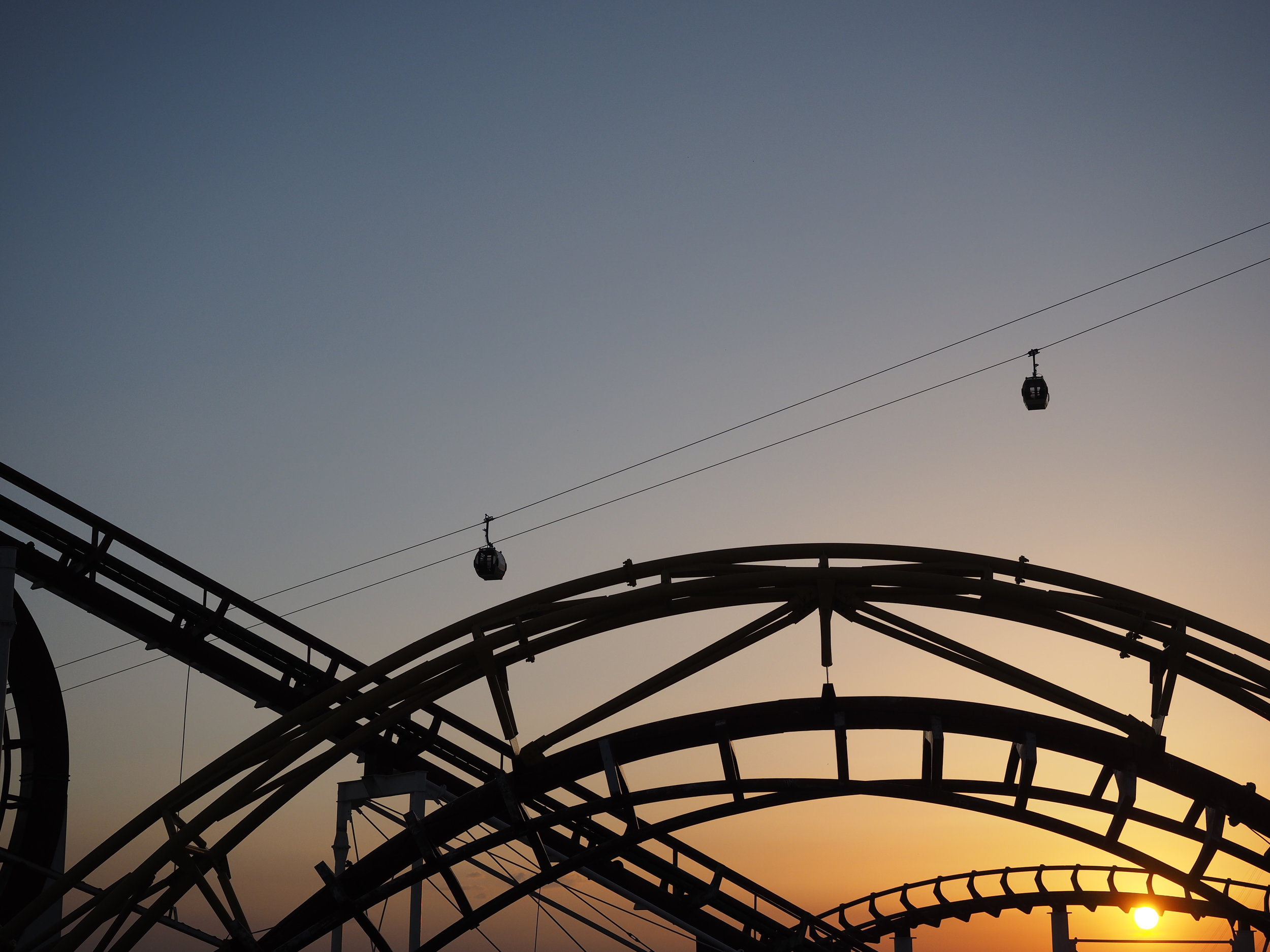 The sun setting over the rides at Chavyland in Sulaymaniyah.