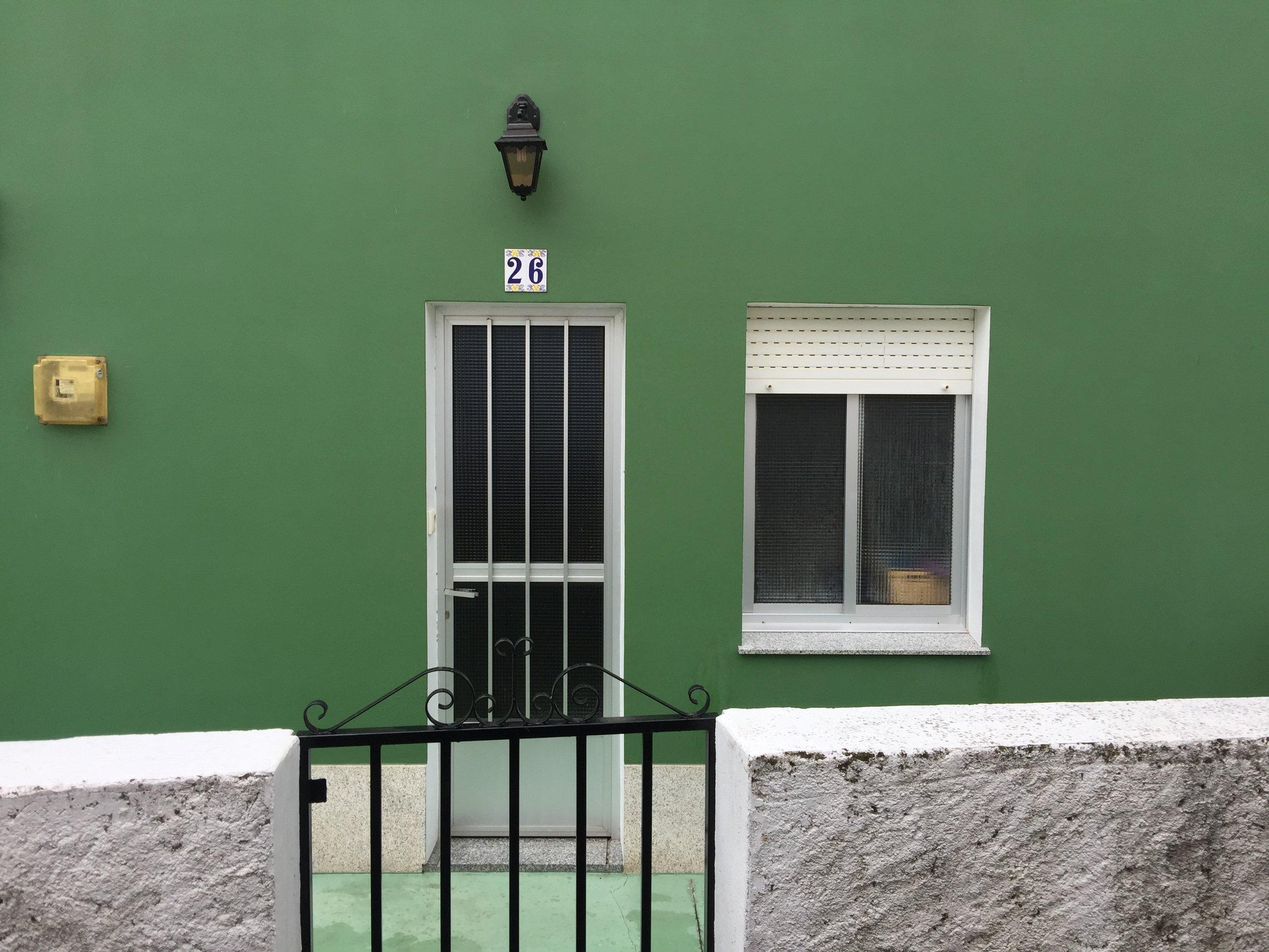 I love the doorways in Spain. Even a bit of 70s aluminium looks good here.