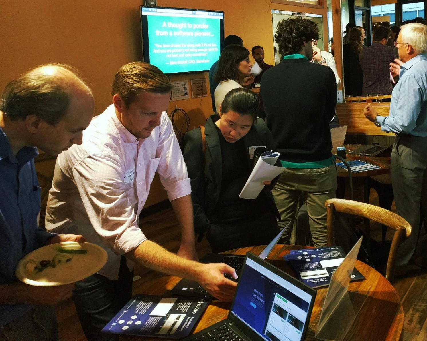 Brian Axline, founder and CEO of Lucro (second from left) demos the product to FinTech Connect attendees.