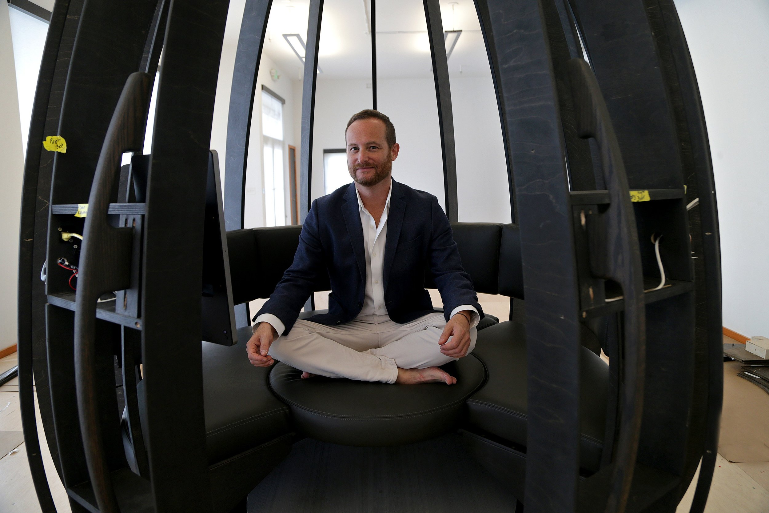 Jonathan Marcoschamer inside a prototype of OpenSeed's meditation pod at CIC Miami.