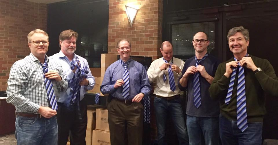 Choir dads to the rescue... pre-tying Varsity Mens Choir ties for the annual All District Choir Concert.