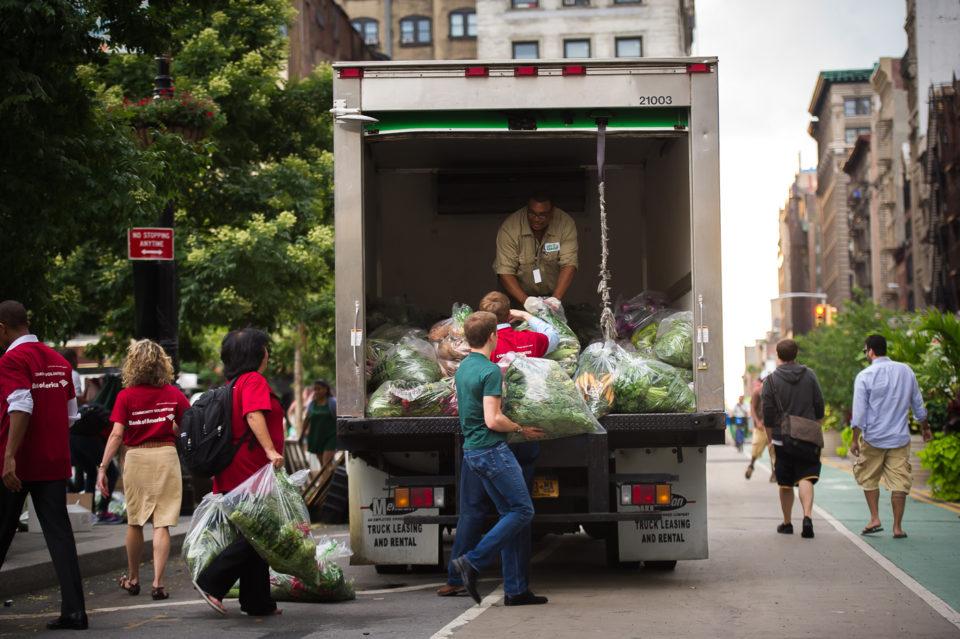 Volunteers help load produce for the City Harvest Greenmarket Rescue program.