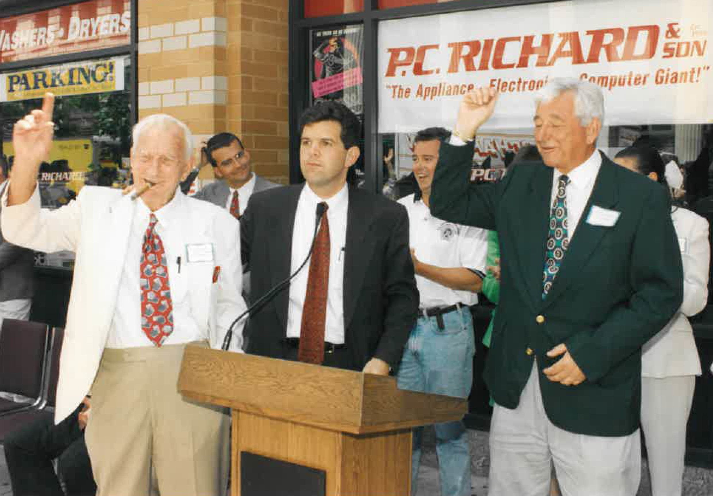 The Richard family and former Union Square Partnership Executive Director Rob Walsh (middle) oversee the grand opening and ribbon cutting ceremony for P.C. Richard & Son's flagship Manhattan store at Union Square in 1996.