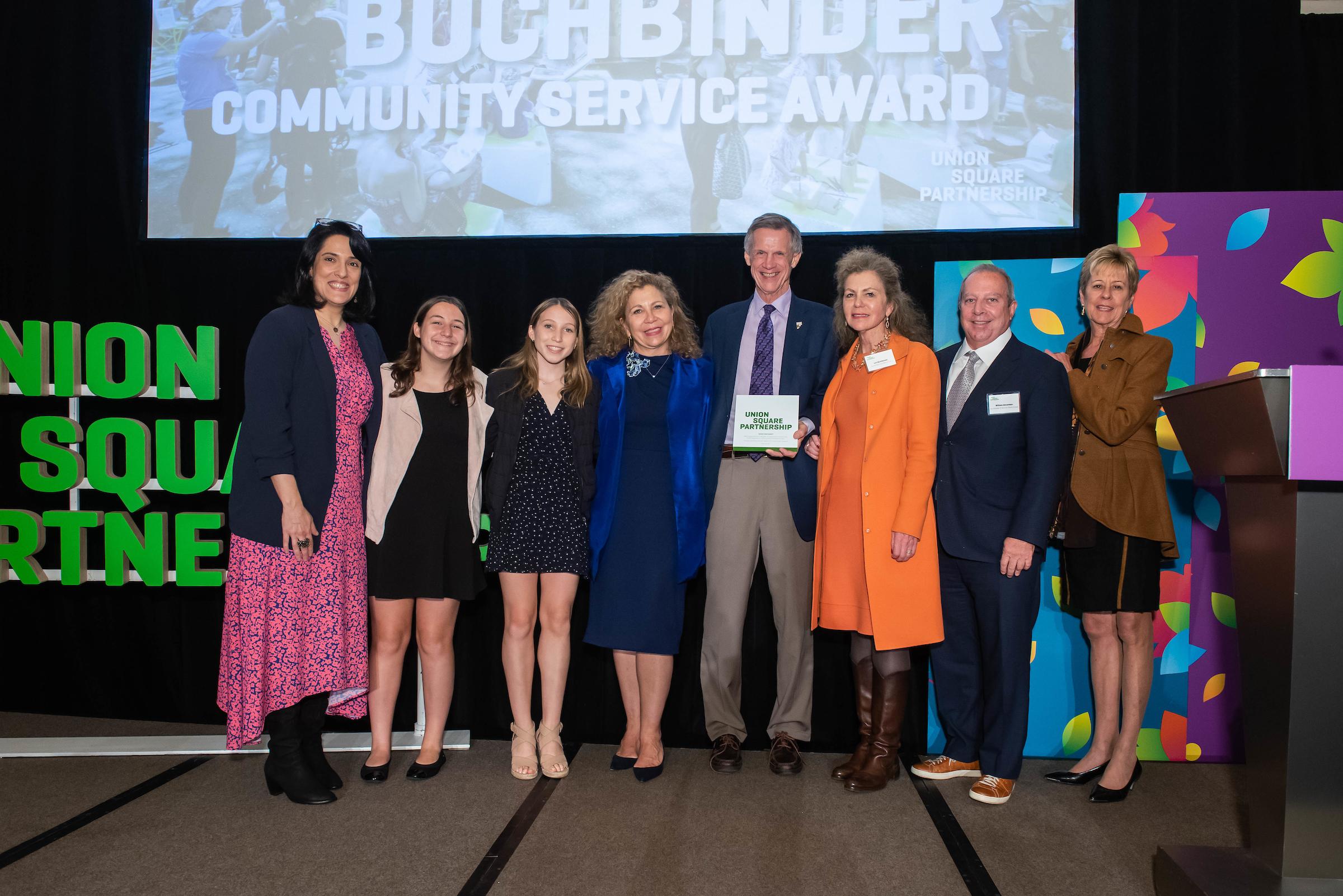 The Buchbinder family presents President Van Zandt with the 2019 Norman Buchbinder Community Service Award