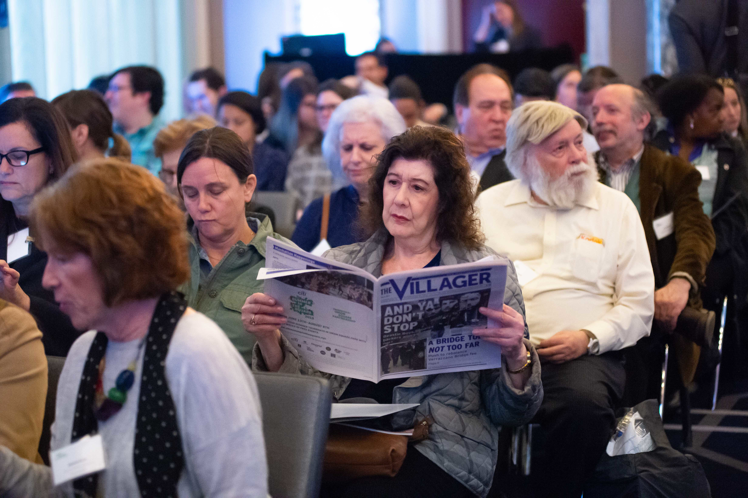 Attendee reads The Villager's 2019 Salute to Union Square
