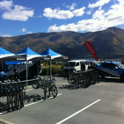 Giant triathlon event with gazebos, flags and event barriers