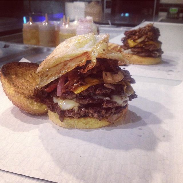 No better cure for a hangover than The Hangover! Featuring 2 fresh beef patties, 2 strips of bacon, 2 slices of premium cheddar cheese, sautéed onions, topped with a fried egg  #tgif
