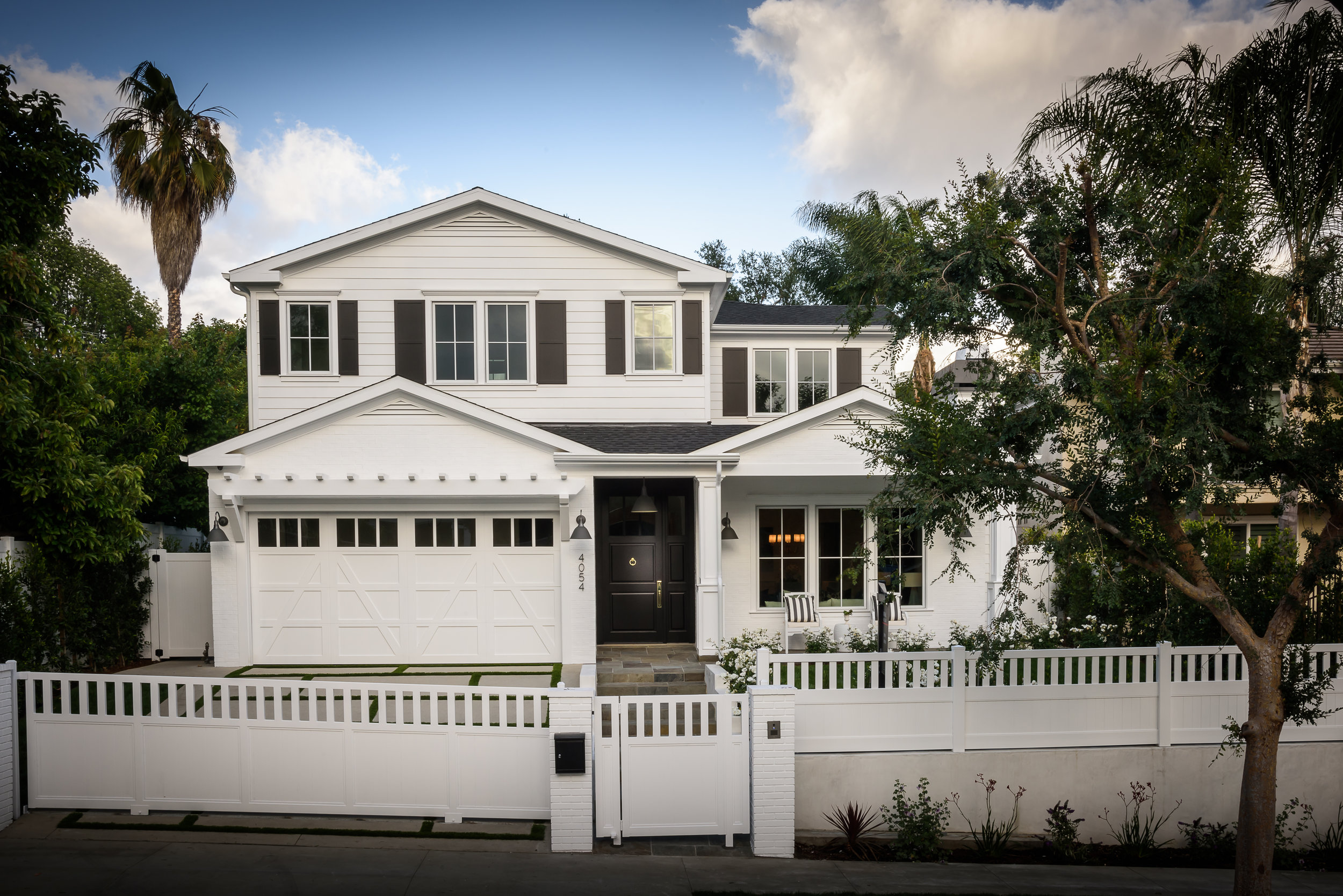 BECK AVENUE | STUDIO CITY   Only the highest standard of quality craftsmanship was utilized when designing this gated Cape Cod traditional style home. Unparalleled in elegance, high-end finishes boasts as you both enter and exit from either side of this private and secure property.