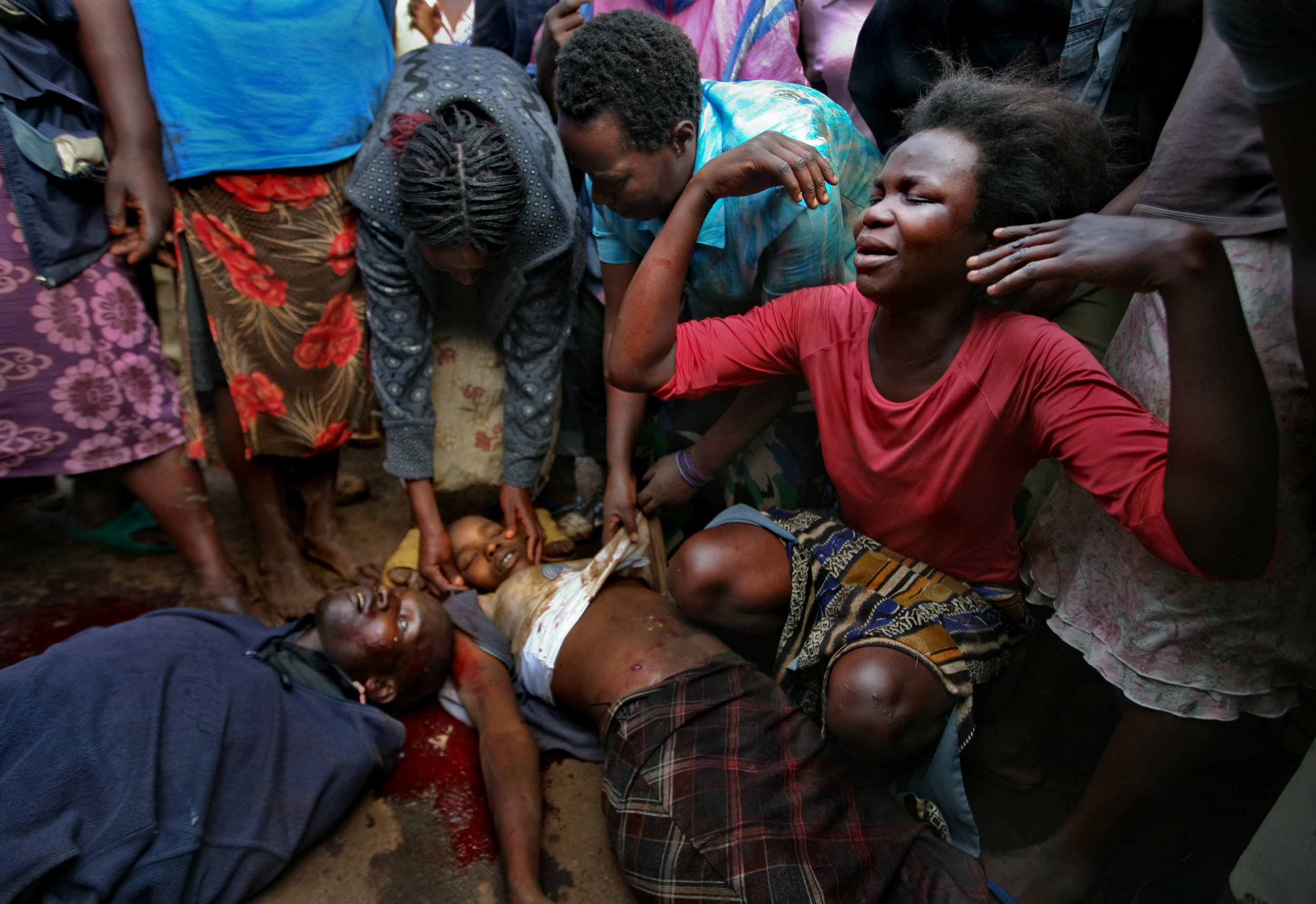 Kibera residents mourn over the bodies of two people just shot dead during opposition protests in Nairobi's Kibera slum. At least eight people were killed that day in violence.