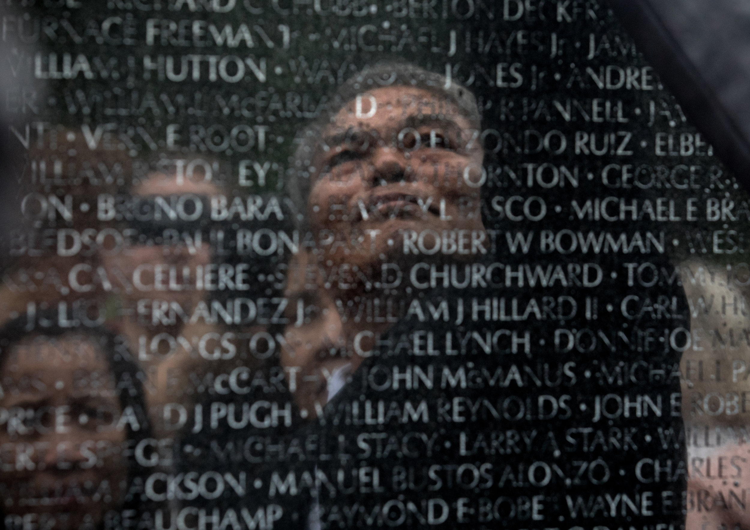 Vu Ngoc Xiem visits the Vietnam Memorial, with the 2Sides project, which brings together Vietnamese and Americans who lost their fathers on both sides of the war. (Photo by Evelyn Hockstein/For The Washington Post)