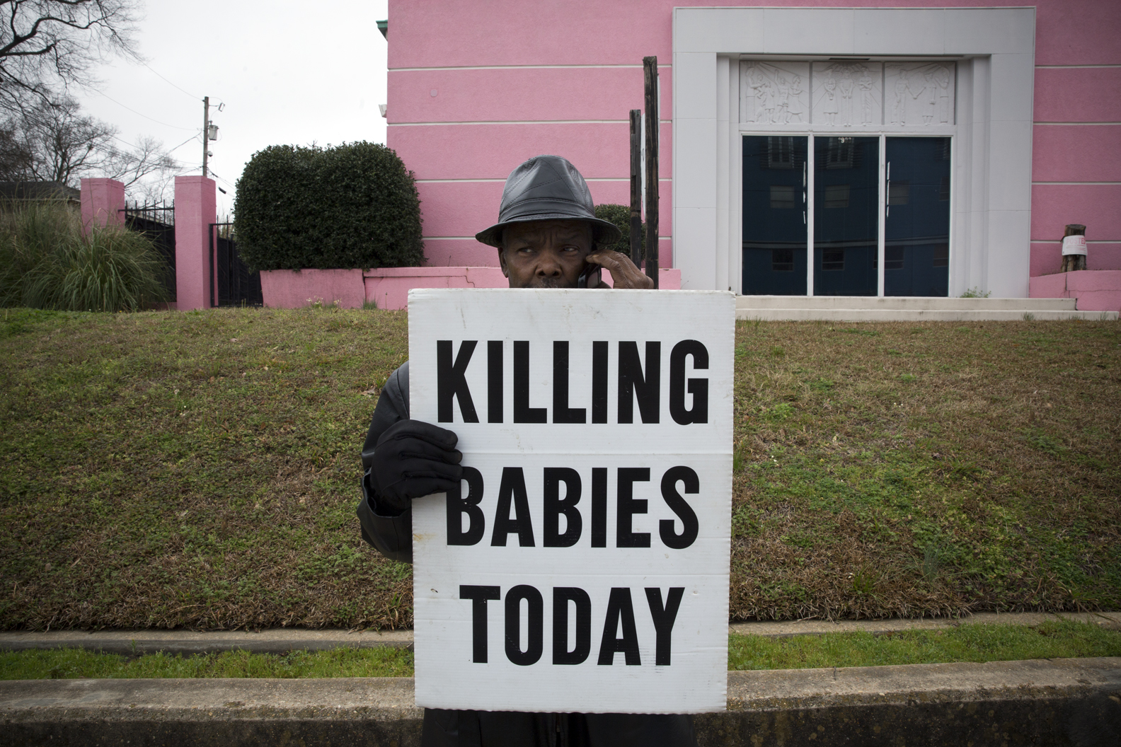 Anti-abortion protestors demonstrate outside the Jackson Women's Health organization, the only abortion clinic in the state of Mississippi.