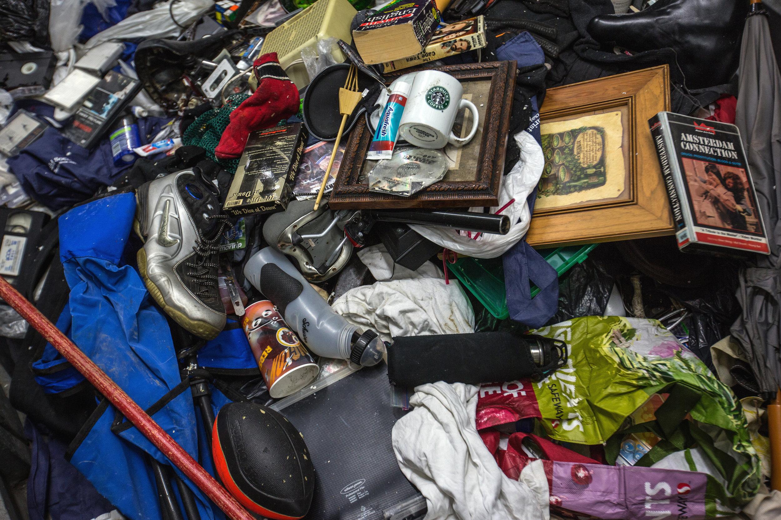Michael Evans sorts through his belongings