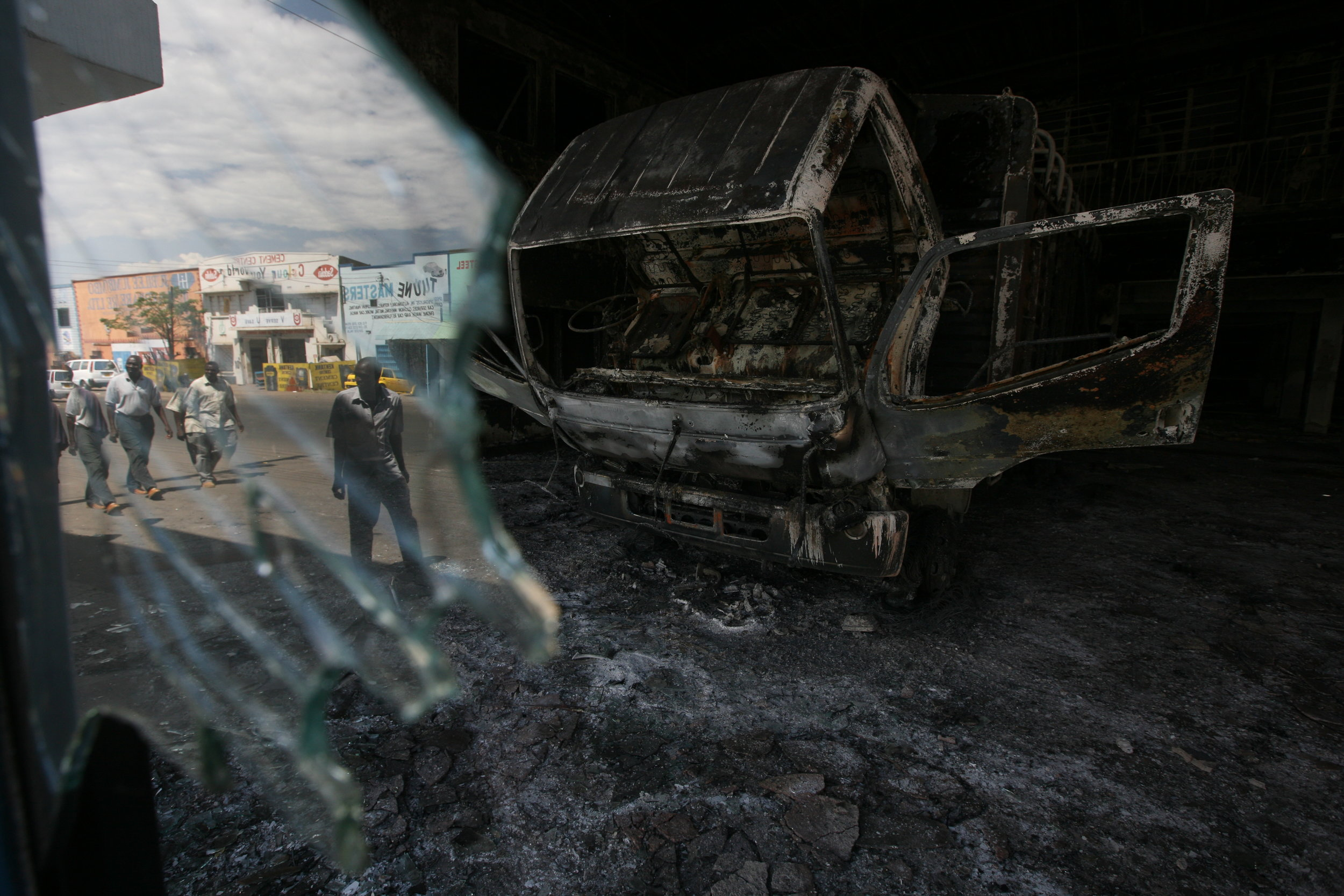 Residents of Kisumu, Kenya's third largest city, stood outside a ransacked car dealership following the wave of looting and rioting that has engulfed the country as it begins to get back to normal after a week of post-election violence that has claimed more than 300 lives nationwide. Few places have been so thoroughly gutted by the turbulence as here.