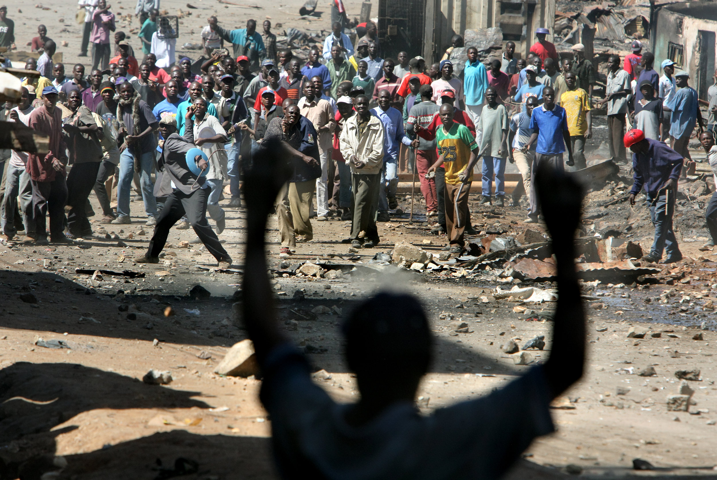 Members of two tribal groups threw rocks at one another across barricades on Tuesday in the Mathare slum.