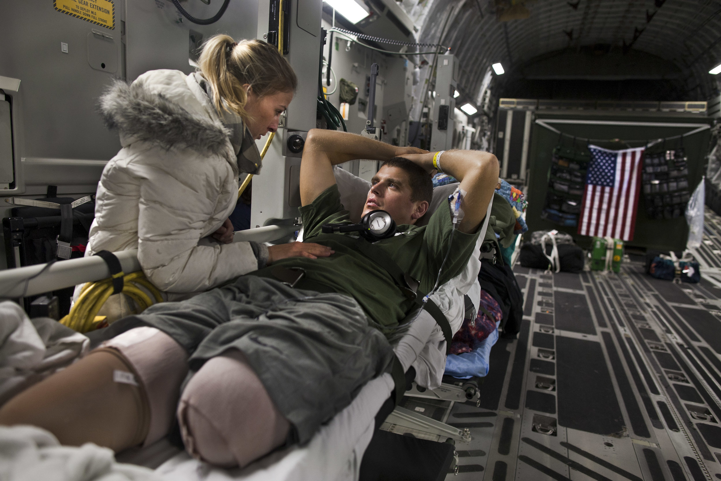 Marine 1st Lieutenant Patrick Glavey, aboard the C-17 Globemaster III. Glavey lost both legs and an index finger after stepping on a IED in Afghanistan. The air evacuation team, provide transport planes to carry injured soldiers from Afghanistan to Germany, and then onto the US. Sometimes the aircraft fly directly from Afghanistan to the US with air-to-air refueling.