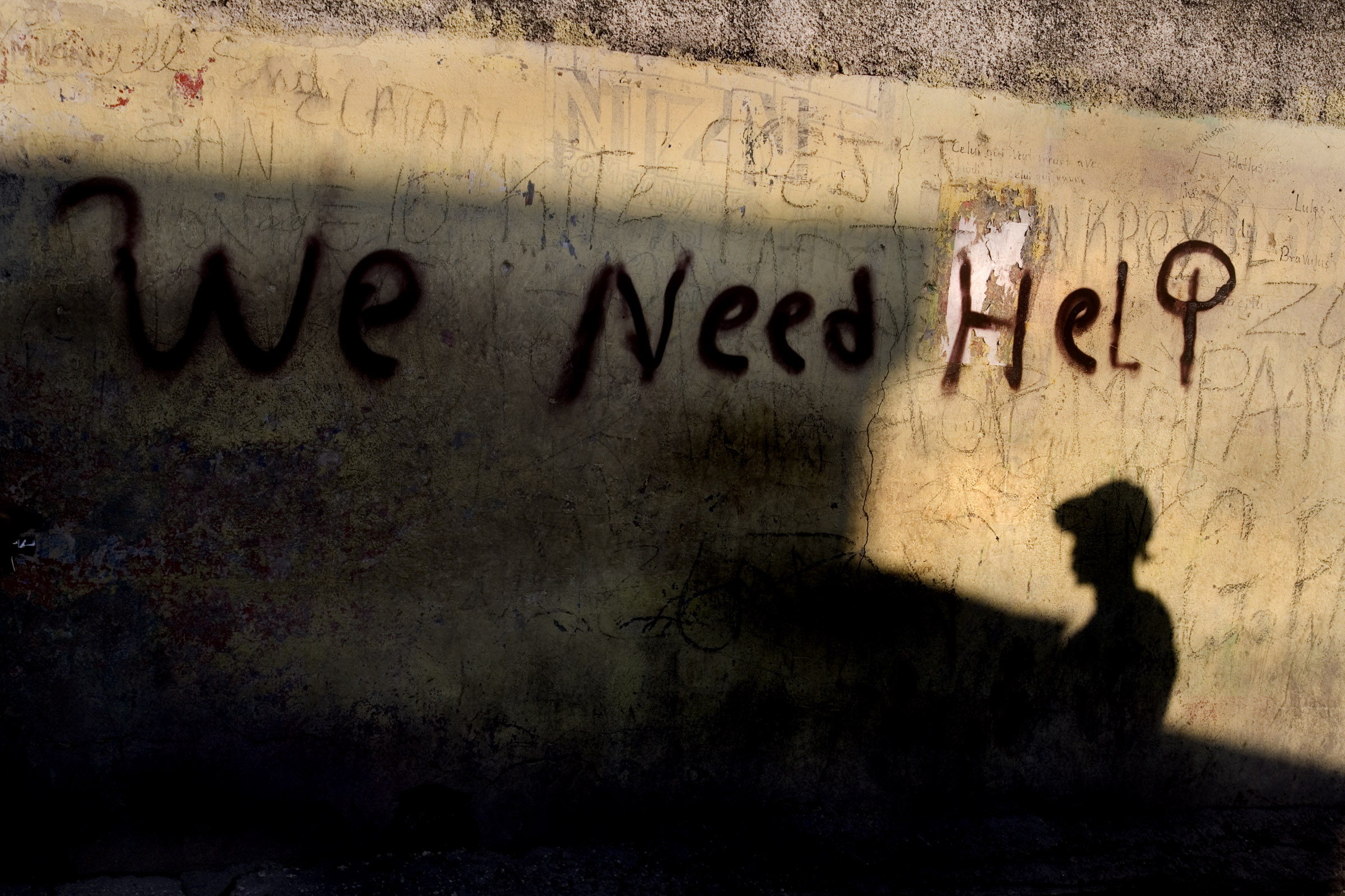 Messages pleading for help line the streets of Port-au-Prince following Haiti's devastating earthquake.