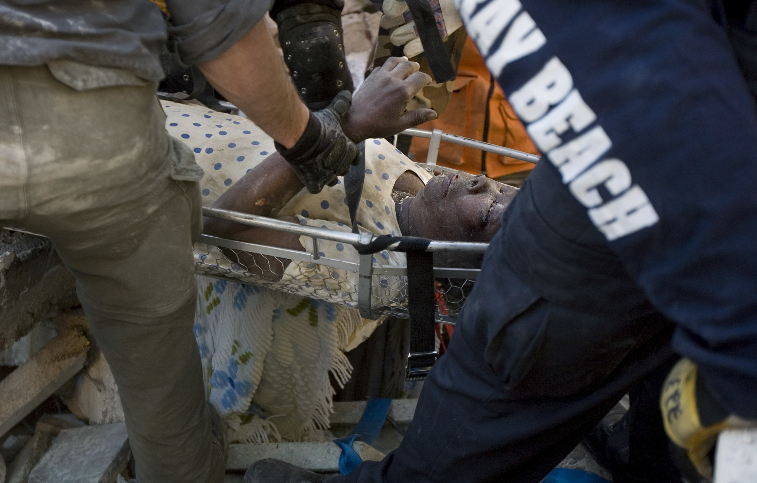 sabel Azou, 58, is pulled out of the rubble alive and conscious after an hours long rescue operation by the Delray Beach fire department and the Rapid Latino America Search and Rescue Team. Three of her children were presumed alive and still trapped under the rubble days after a devastating earthquake struck Haiti.