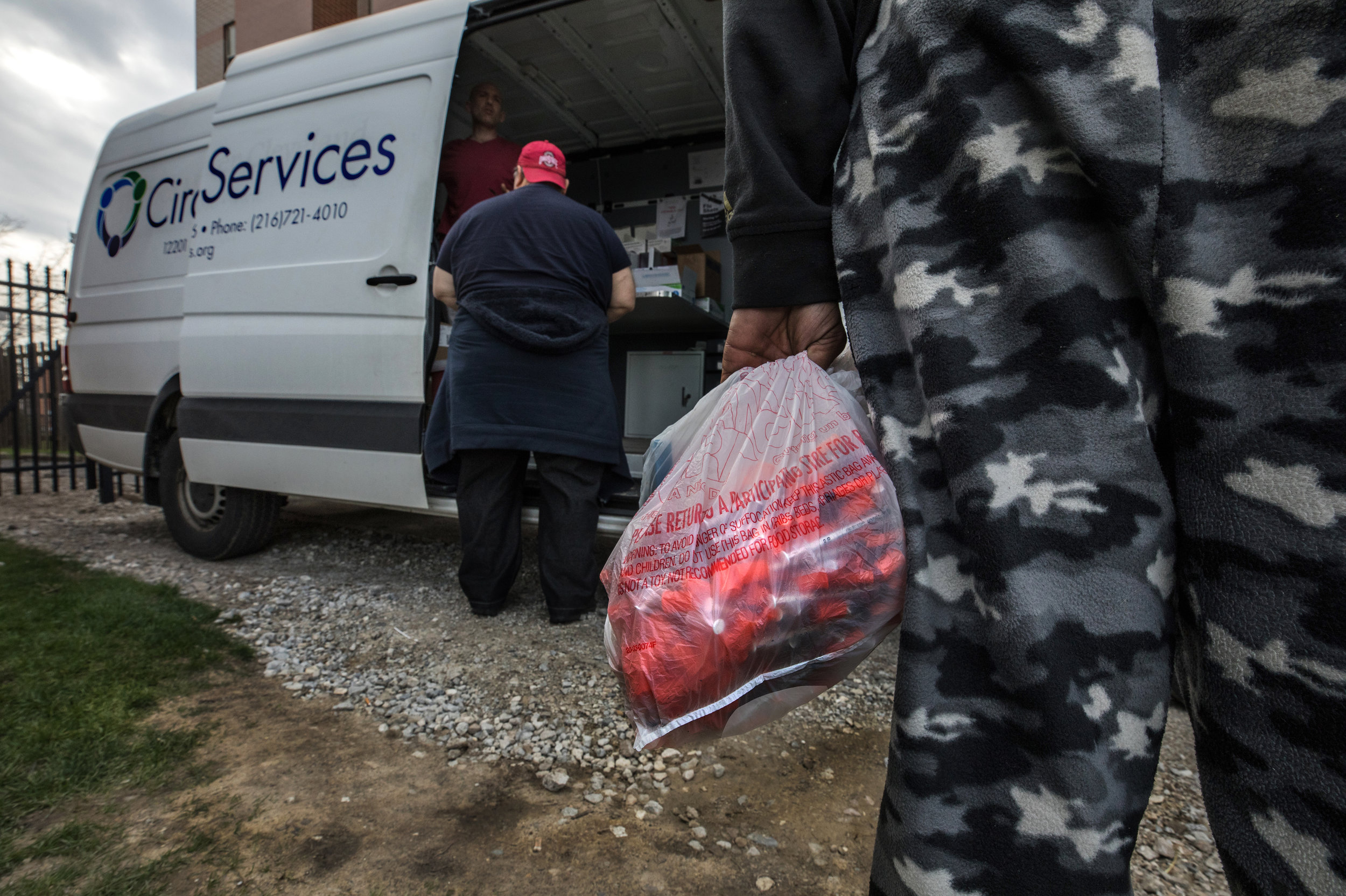 A client waits to exchange used hundreds of used syringes for clean ones at the Circle Heath Services Syringe Exchange van.