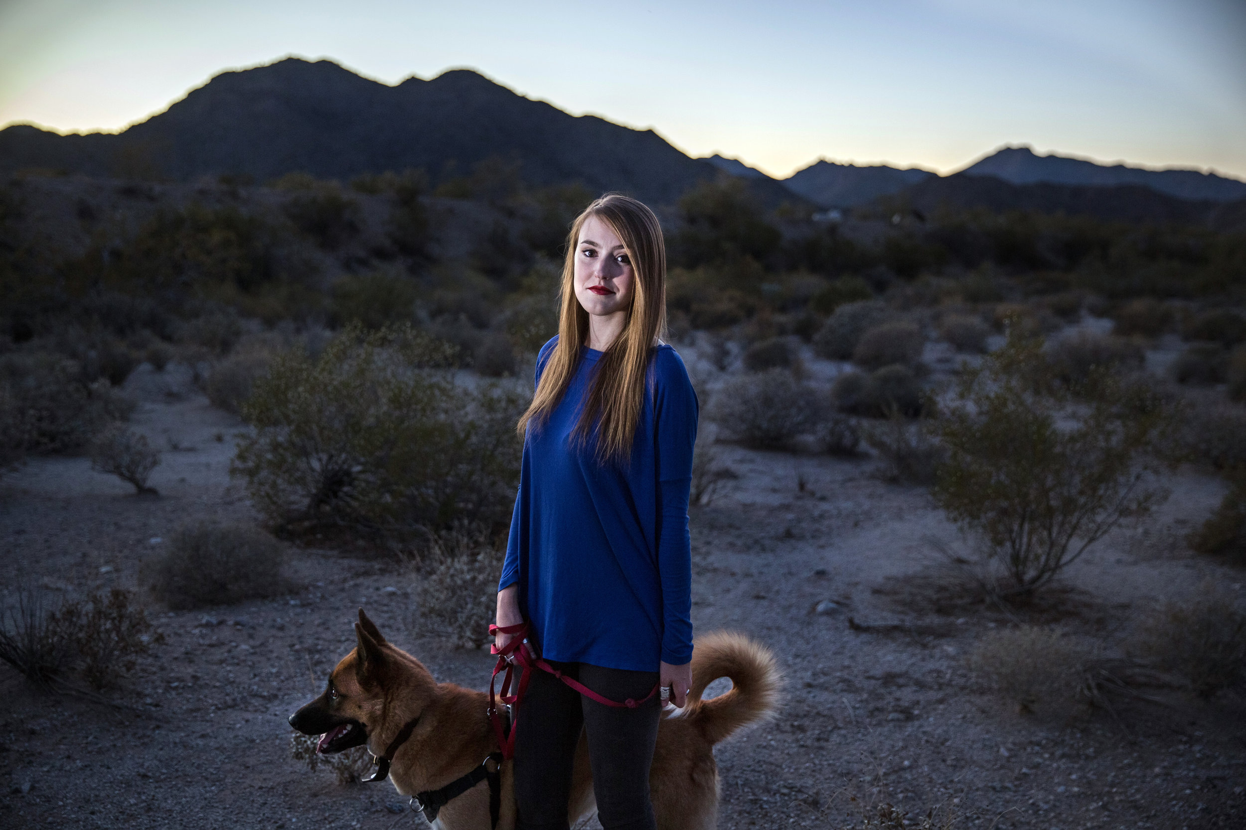 "Kristina Erickson, 23, walks her dog Atticus outside of Phoenix, AZ where she is a school teacher. She graduated in 2013 from Beloit College in Wisconsin. While she was there, in her senior year, a man she didn't know grabbed her in the crotch at a party in a public setting (basement of a fraternity house). She joined with other women in pursuing a sexual misconduct complaint through the college disciplinary process. She was raped at an earlier point in her career at Beloit in a dorm room by someone who thought her repeated ""no"" and ""stop"" was a joke. She does not want to identify that person, and she never reported it to police or the college. She wrote about her experiences in an essay for the college student newspaper."
