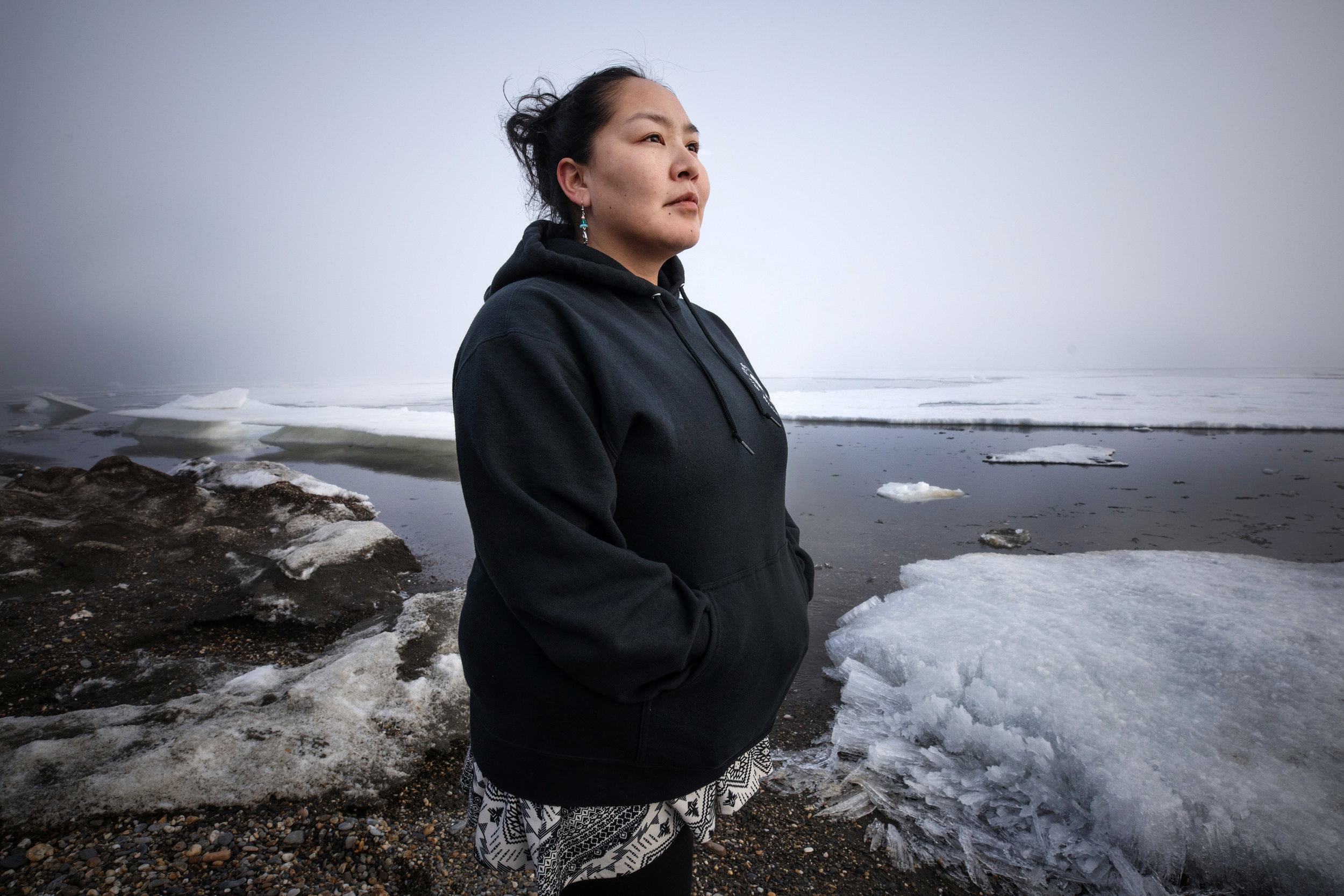 Meghann Piscoya, grew up in Shishmaref, Alaska, a traditional Inupiaq village under imminent threat from climate change. Residents rely heavily on a subsistence lifestyle, hunting and gathering much of their food, but the community has voted to relocate as the shoreline rapidly erodes and the permafrost melts.
