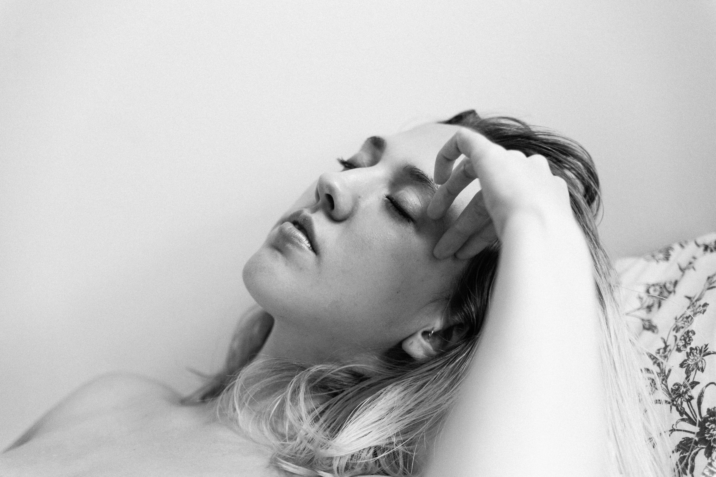 natural light black and white portrait of a woman feeling amazing