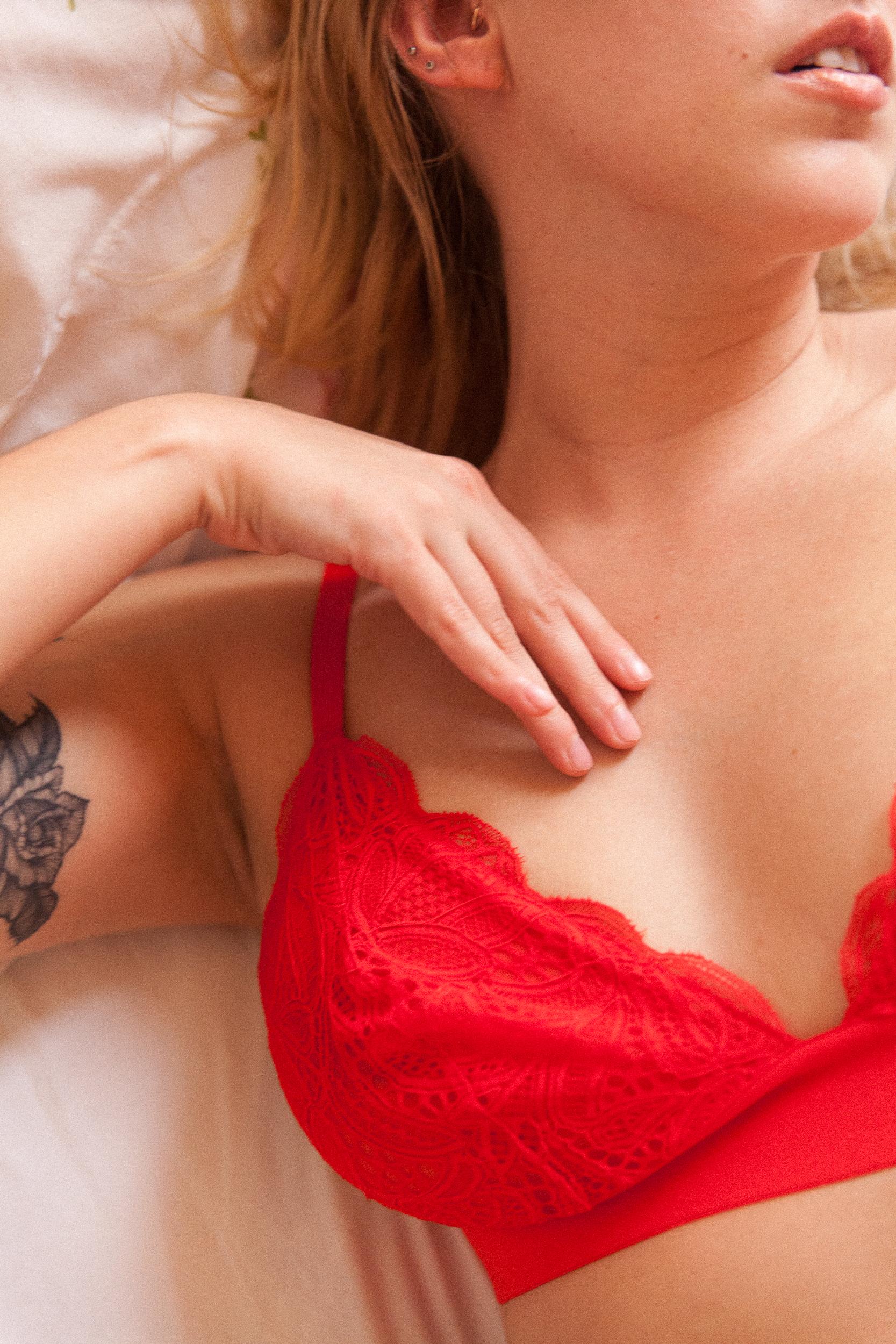 Sensual portrait red lingerie tattooed girl