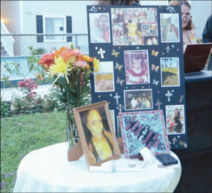 Photos of Brandy Johnson were displayed at a memorial service held for her at Lyn Gardens Apartments on June 21.  Beacon photo/Anthony DeFeo