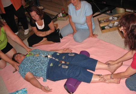 Professional Crystal Healer students learning Chakra Balancing session using Crystals & Gemstones.