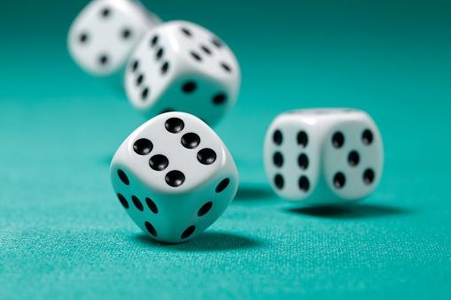 rolling_dice_on_table-ThinkstockPhotos-519275102.jpg