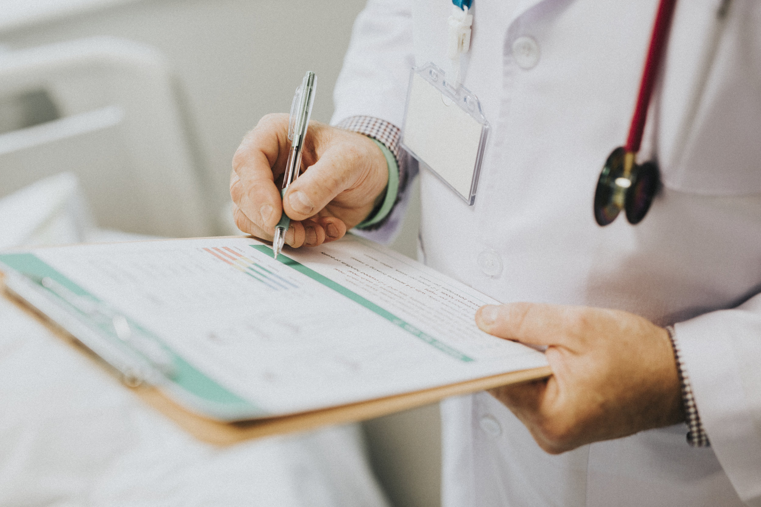 Physician noting down symptoms of a patient