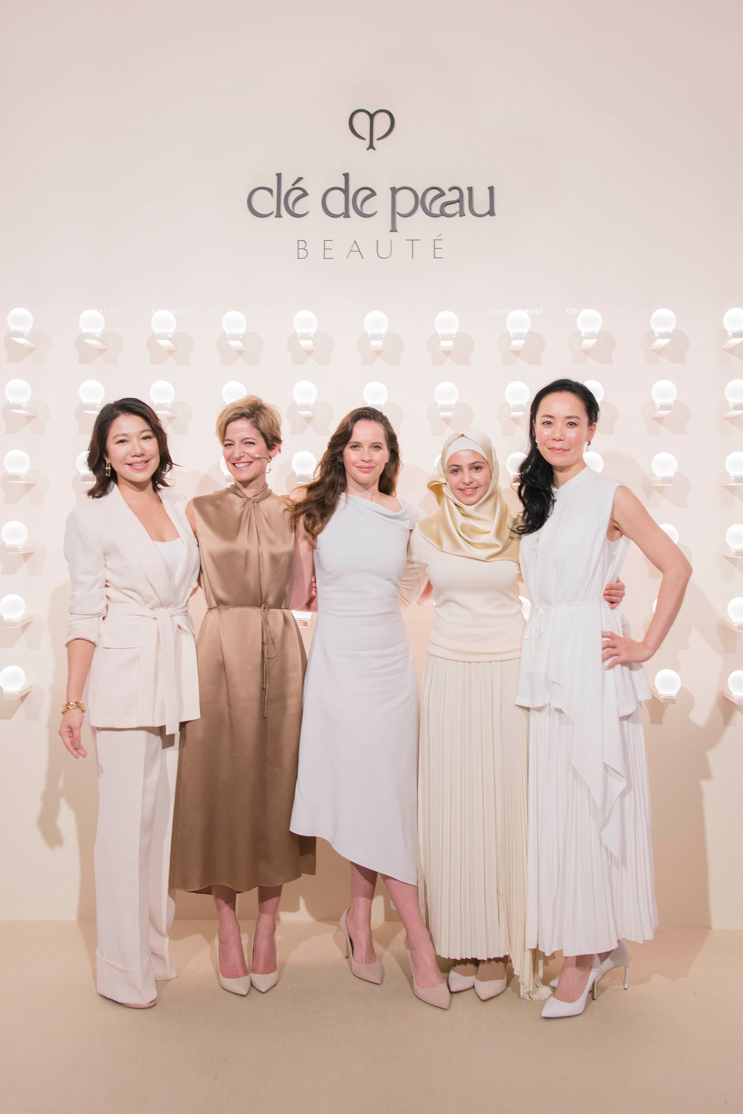 Left to right:  Actress Belinda Lee; Former  Glamour  Editor-in-Chief Cindi Leive; Felicity Jones; Power of Radiance Recipient  Muzoon Almellehan ; Film Director Naomi Kawase