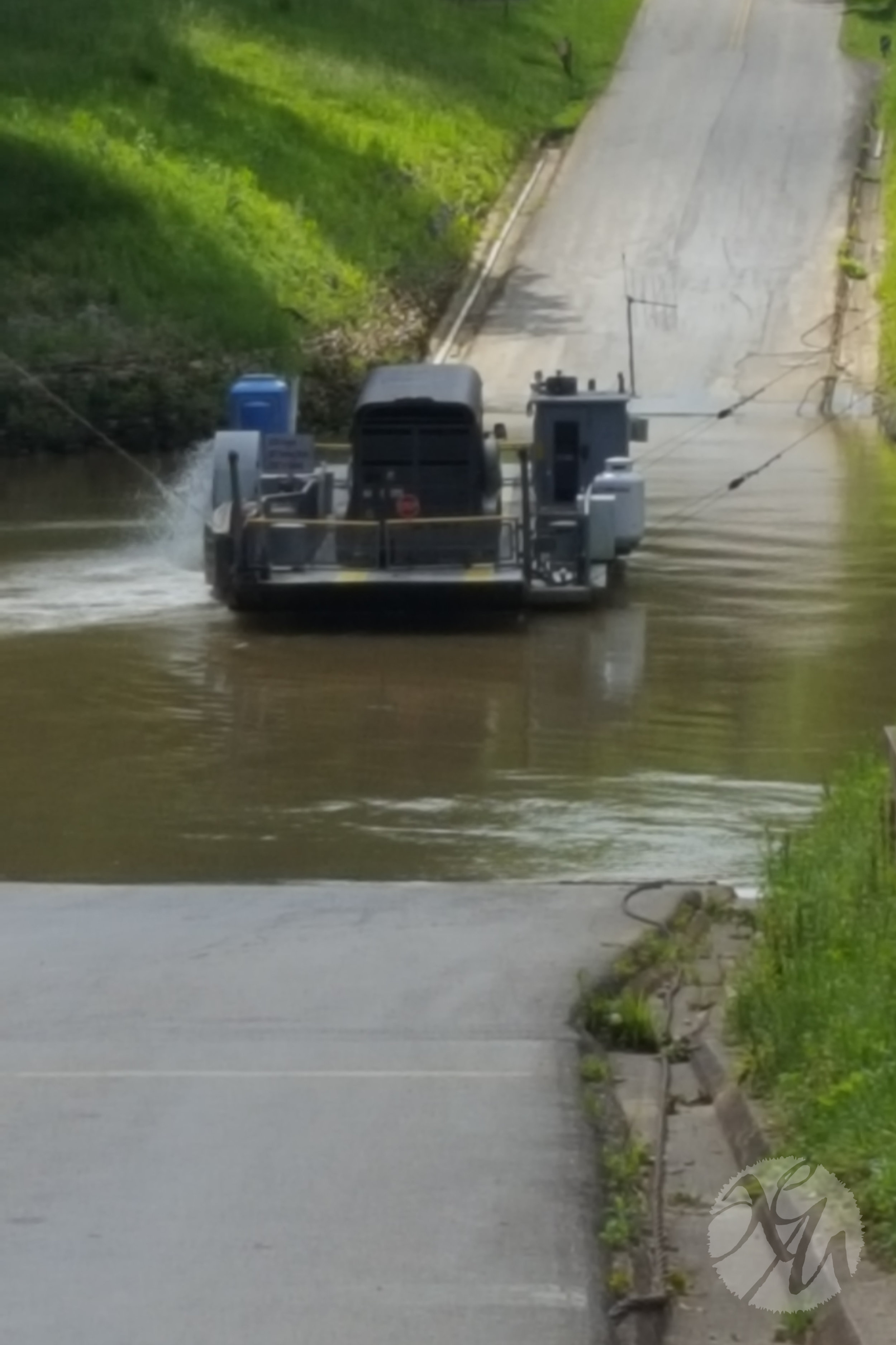 One-car, old-fashioned ferry across the river. It was anchored to guiding wires that stretched high from one side to the other, so even when the river is at flood stage, the road is passable. Simple but smart!