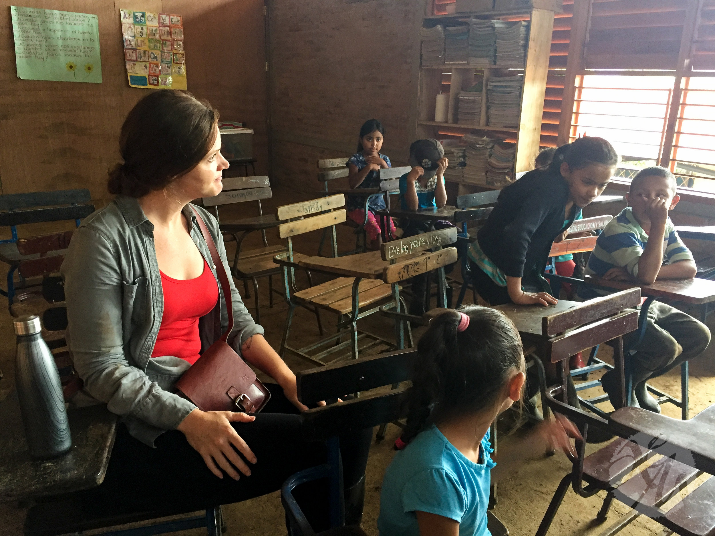 Project Alianza founder Kristin Van Busum sits among students at one of Alianza's first rural schools in Nicaragua.