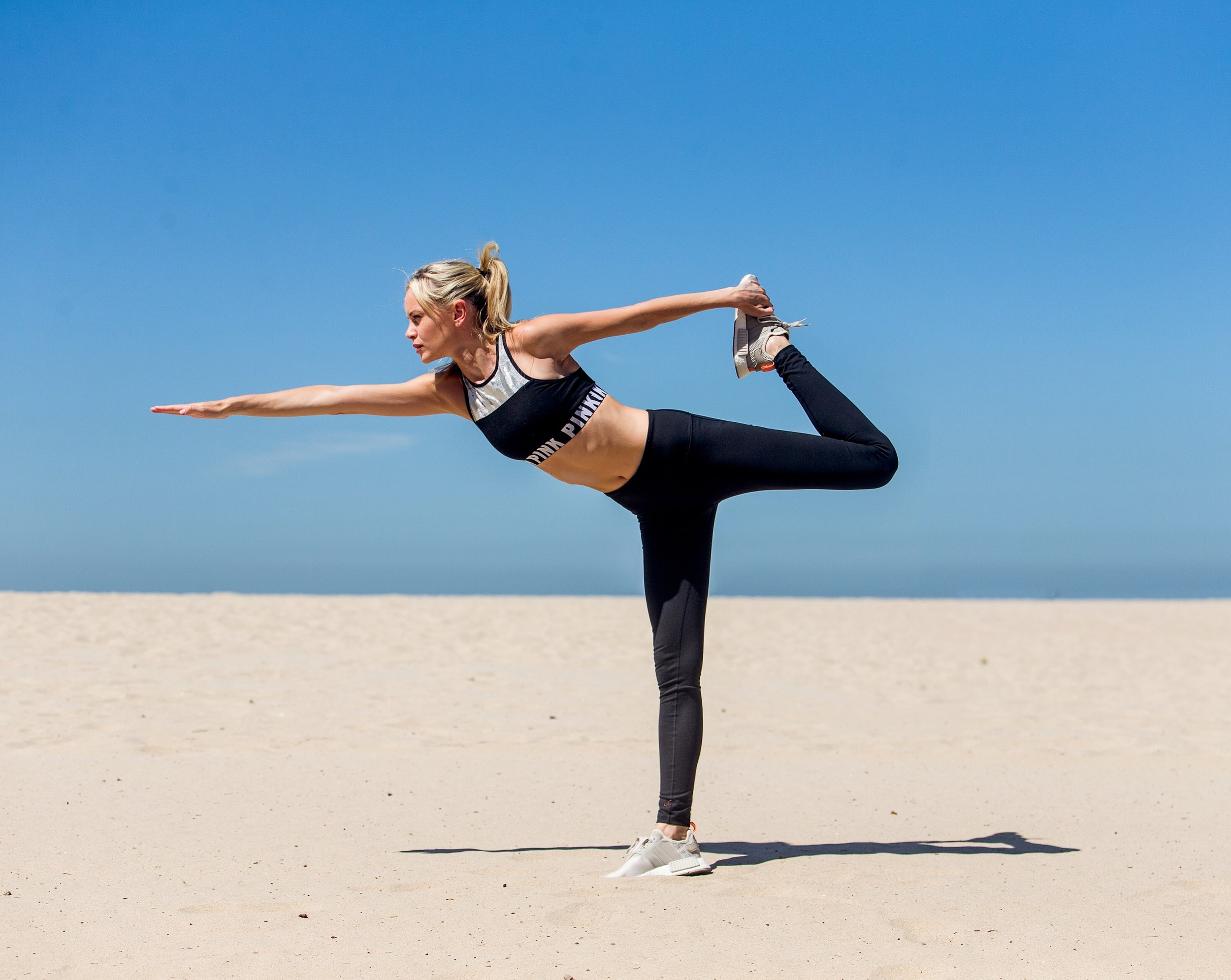 One Model Mission's Katy Johnson attempting a warrior 3 pose.