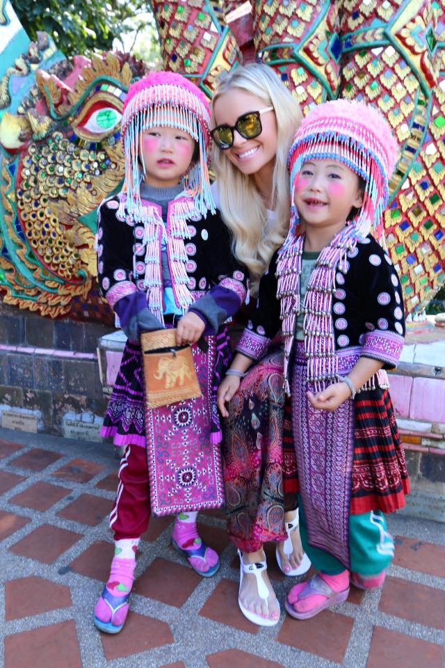 Travel Blogger Katy Johnson with fans in Asia.